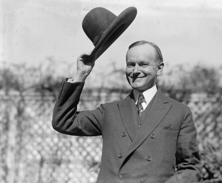 Coolidge tips hat